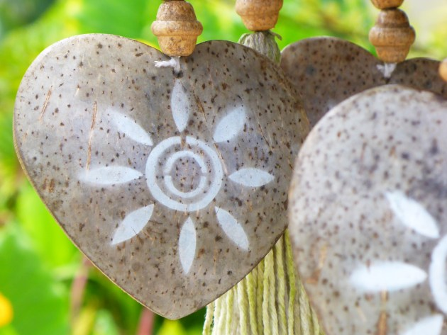 hanging wooden heart decorations on a blurred green background