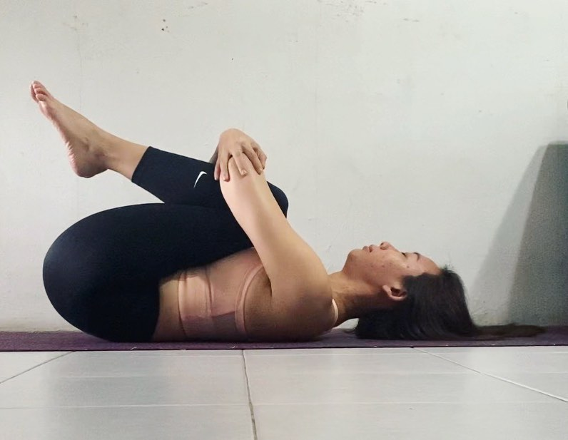 Restorative knees to chest pose Bend the knees) - Fitzabout