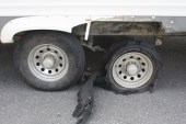 damage-from-tire-blowout-on-rv