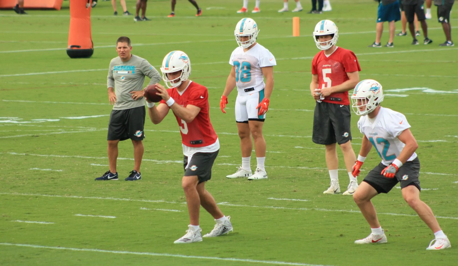 Josh Rosen, taking a snap in minicamp, has a lot of work to catch up to veteran Ryan Fitzpatrick. (Craig Davis/Fivereasonssports.com)