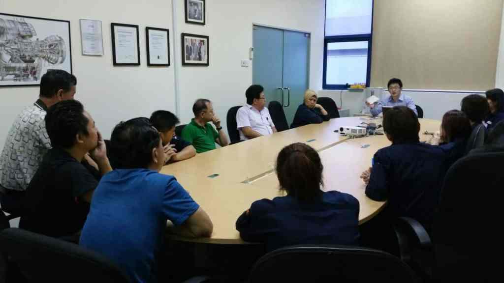 Jayden giving union members an update on their owed salaries.