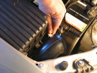 Air filters typically are found in a plastic box at one side of the engine or the other. To open, remove the latch or screws.