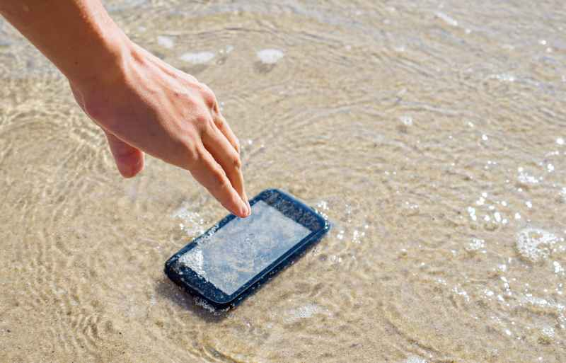 Phone drops into water