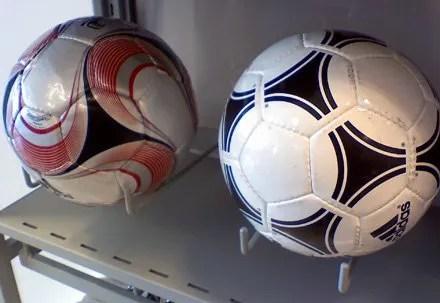 Utility Hooks display soccer balls among sportswear offerings.