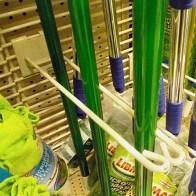Broom Hook Bottom Retainer as Retail Merchandising Fixture