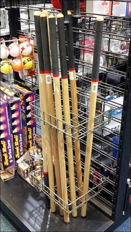 Stickball Bats In Slatwire Racks Fixtures Close Up