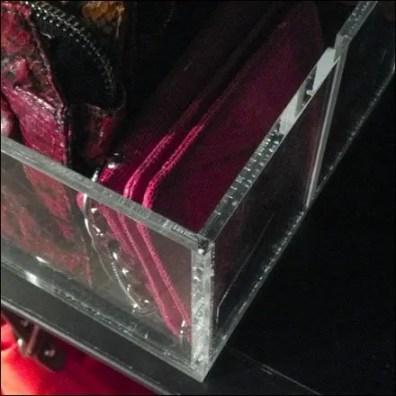 Purses in Acrylic Tray Closeup