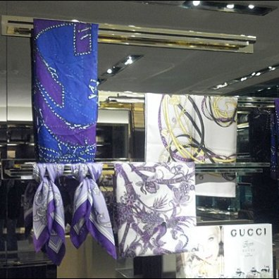 Gucci Ties a Scarf Knot Overall