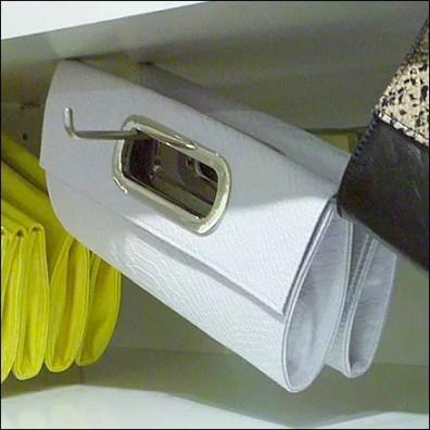 Purses Hooked Askew Main on Bar Mount 90º Tip Display Hooks as retail merchandising store fixture Detail Closeup