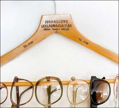 Eyeglasses on Clothes Hanger Detail