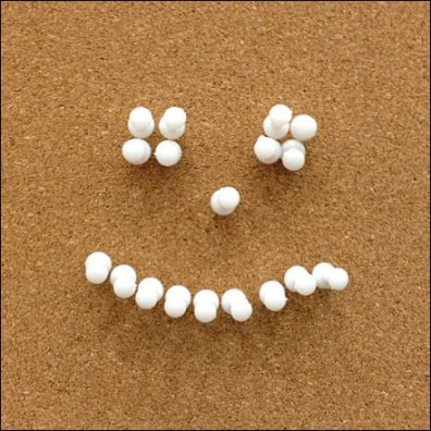 Cork Board Smiley Thumbtack Closeup