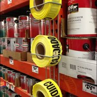 Spanish Caution Tape Pallet Rack Merchandiser Main