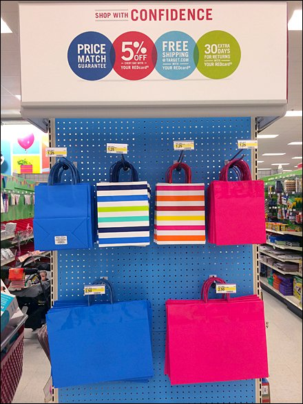 Gift Bags on Blue Pegboard Endcap Front