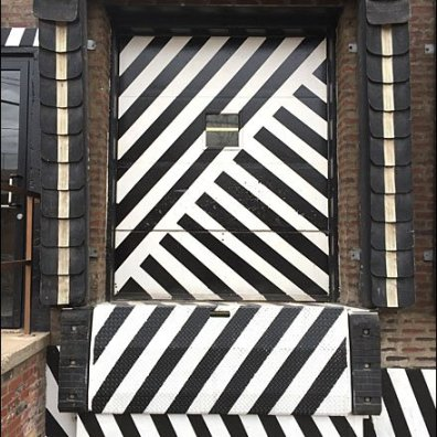 Maines Source Retail Fixtures - Maine Source Dazzle Paint Loading Dock Door Main
