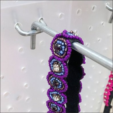 Translucent Plastic Pegboard All Wire Hooks Closeup