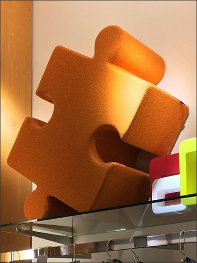 Plush Puzzle Piece on Shelf