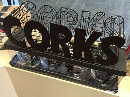 Silhouetted and Wire Formed Corks on Sale Sign