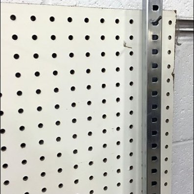 Merchandiser Bar Storage On Pegboard 2