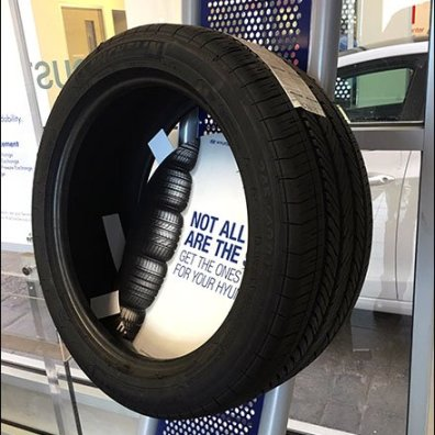 Perforated Tire Display Created From Curved Elements