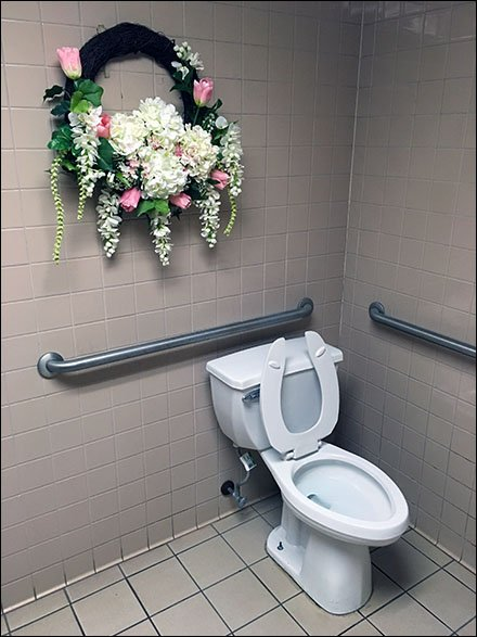 Brighten Your Retail Restroom With A Floral Wreath Fixtures Close Up - Retail bathroom fixtures