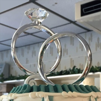 Bakery Delight Engagement Ring Wedding Cake Topper Feature