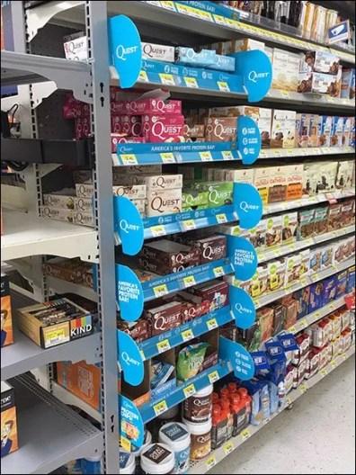 quest-branded-shelf-edge-divider-and-flag-1