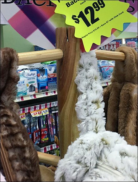 Plushes Pegged On Wood Display Pole