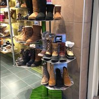 Stacked and Staggered Hexagonal Floor Stand for Boots
