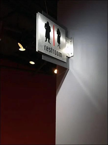 Spy Museum Restroom Navigation Sign