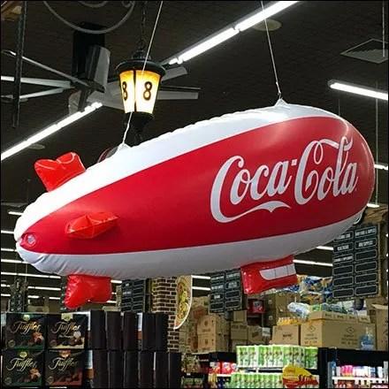 Coca-Cola Blimp Cruises Cashwraps At Food Bazaar