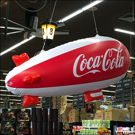 Coca-Cola Blimp Cruises Cashwraps At Food Bazaar