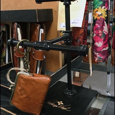 Patricia Nash Pipe Rack Purse Display