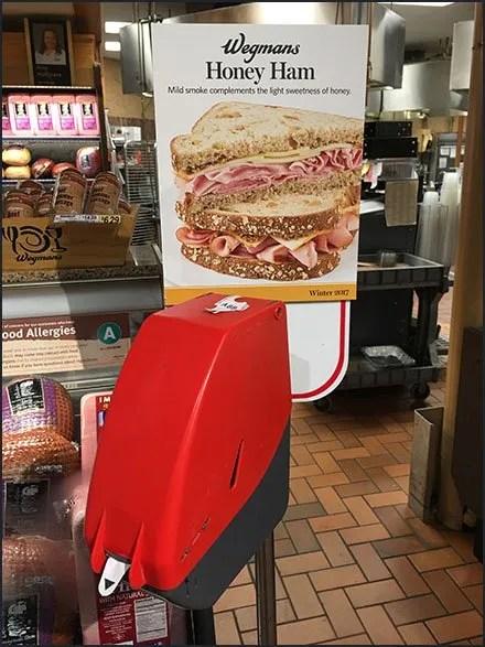 Queue Ticket Dispenser Advertises Deli Honey Ham