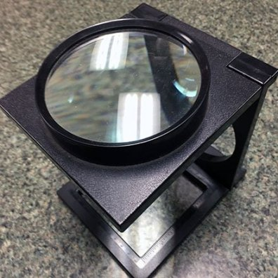 Rago Bros Giant Loupe Magnifier Feature