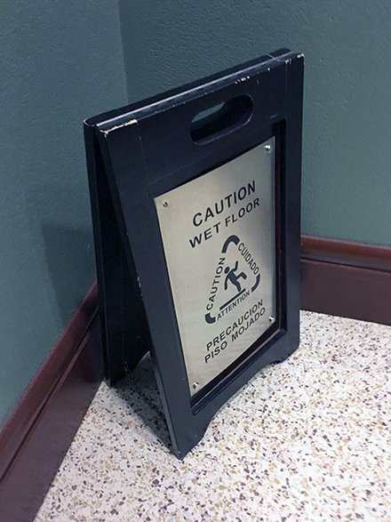 Wood-And-Stainless Wet Floor Warning