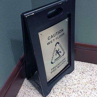 Wood And Stainless Wet Floor Warning