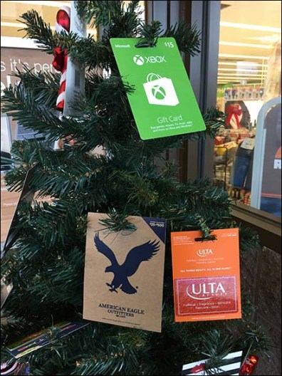 Decorate your christmas tree with gift cards fixtures close up decorate your christmas tree with gift cards negle Choice Image
