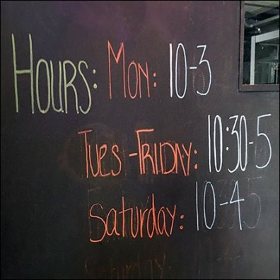 Blackboard Door Hosts Store Hours And More Feature