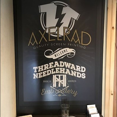 Axelrad and Threadward Needlehands Stairwell Branding