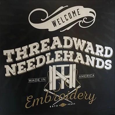 Axelrad and Threadward Needlehands Stairwell Branding