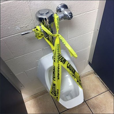 Do-It-Yourself Caution Tape Urinal Closure