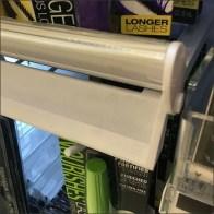Elliptical Shelf Edge Label Holder Flips Up