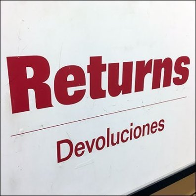 Returns Processed Here Designator Sign