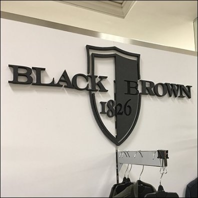 Black and Brown Branded Apparel Display Feature