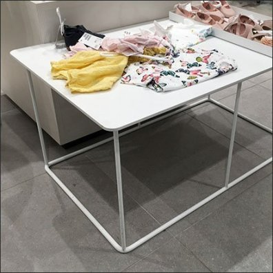 White Wire-Frame Display Table Merchandising