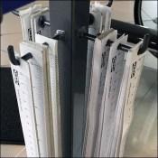 Paper-Tape Yardstick Measures Merchandise