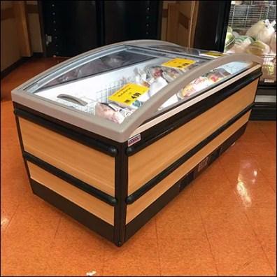 Graceful Curved Coffin-Case Cooler Display