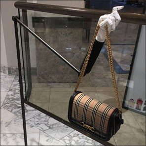 Articulated Arm Hands Out Burberry Purses