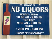 NB Liquors Welcoming Hours Sign