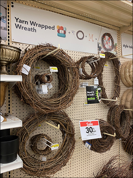Yarn-Wrapped Wreath Pegboard Display